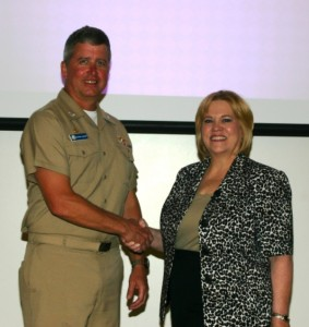 Carolyn is welcomed to Sigsbee Naval Air Base by Commanding Officer Patrick LeFere
